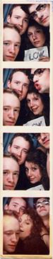 Alan, Mimi, John, and Zak in a photobooth